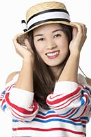 Portrait of a Beautiful Chinese American woman displaying a bit of attitude isolated on a white background.