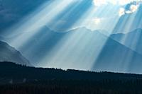 sun, clouds and mountains in Waterton Lakes National Park, Alberta, Canada.