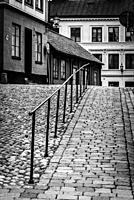 Cobbled hilly street with traditional houses in Sodermalm, Stockholm, Sweden.