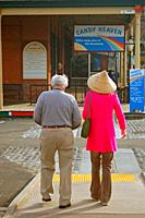 An elderly couple takes a walk through the historic Old Sacramento neighborhood.
