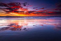 Sunset over the Channel Islands from Ventura State Beach, Ventura, California USA.