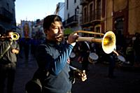 A man plays a cornet during a parado honoring Our Lady of Guadalupe in Guanajuato, Mexico.