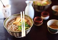 Bowl of Ramen with Soba noodles and tofu on a table in a Japanese restaurant, Kyoto, Japan.