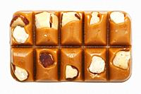 A slab of Walker's Brazil Nut Toffee on a white background.