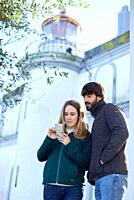 Couple, Lighthouse of Santa Clara Island, Donostia, San Sebastian, Gipuzkoa, Basque Country, Spain, Europe, Winter