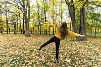 girl enjoying the autumn in the Prater park, Vienna, Austria
