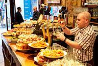 Waiter serving beer, Pintxos, Bar Taberna Aralar, Parte Vieja, Old Town, Donostia, San Sebastian, Gipuzkoa, Basque Country, Spain