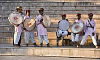 Traditional Rajasthani drummers on the ghats, Pushkar, Rajasthan, India.