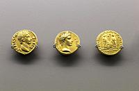 Three golden coins of Augustus Emperor at National Museum of Roman Art in Merida, Spain.