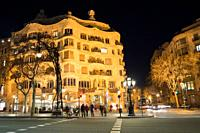 Gaudi's Casa Mila aka La Pedrera after dark, in Barcelona, Spain.