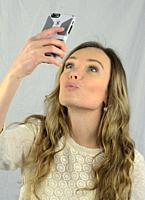 Young woman make a selfie with her smartphone.
