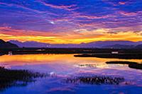 Salt marshes at dusk. Cerroja water mill. Santoña, Victoria and Joyel Marshes Natural Park. Cantabria, Spain, Europe.