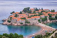 Sveti Stefan islet and five star Aman Sveti Stefan hotel resort on the Adriatic coast of Montenegro.