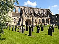 Historic Malmesbury Abbey in spring sunshine, Wiltshire, UK.