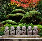 Six cute little monks, Buddhas, stone statues, kawaii garden decor in Kyoto, Japan.