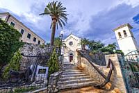Catholic Church of Saint Jerome and bell tower on Mica Pavlovica Square on the Old Town of Herceg Novi city on the Adriatic Sea coast in Montenegro.