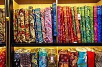 Selection of batik fabrics for sale in Hamzah Batik shop. Yogyakarta, Java, Indonesia.