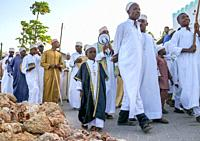 Sunni muslim people parading during the Maulidi festivities in the street, Lamu County, Lamu Town, Kenya.