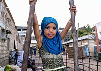Young girl dressed with a blue veil, Lamu County, Lamu Town, Kenya.