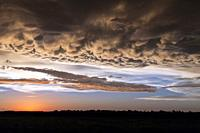 A clearing storm and clouds on the prairies at sunset near Winkler, Manitoba, Canada.