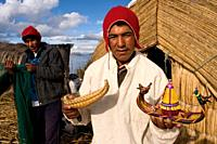 Uros Island, Lake Titicaca, peru, South America. Traditionally, hunting and fishing were the basic mode of subsistence of the Uros, but with the promo...
