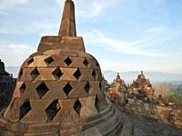 Rhombus holed stupa in Borobudur Buddhist Temple. Magelang Regency, Java, Indonesia.
