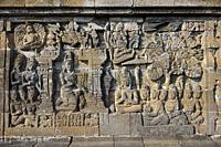 Reliefs on a corridor wall. Borobudur Buddhist Temple, Magelang Regency, Java, Indonesia.