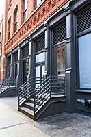 New York City, Manhattan, Soho. Looking at a Typical Cast Iron Building and a Store with a Cast Iron Stairway.