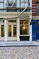 New York City, Manhattan, Soho. Close Up of a Retail Store and Apartments in a Cast Iron Building.