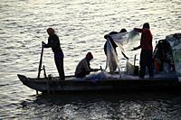 Fishermen at sunrise,Tonlé Sap river,Phnom Penh,Cambodia,South East Asia,Asia.