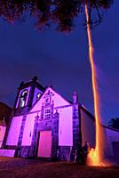 Holy Spirit Festivity Fireworks by the Church in Manadas, twilight, Sao Jorge Island, Azores, Portugal.