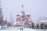 Moscow Kremlin and St. Basil Cathedral on a snowfal. , Moscow, Russia.