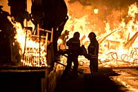 "Firefighters at work during the night of """"La Crema"""" the burning at the Valencian town hall square as part of the last day of las Fallas festival in ..."