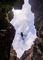 Rescue Helicopter over Barranco de Masca, gorge, Teno Massif, Tenerife Island, Canary Islands, Spain.