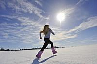 young girl walking on a field covered of snow, department of Eure-et-Loir, Centre-Val-de-Loire region, France, Europe.