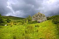 UK, Devon, Dartmoor, a stormy sky over industrial heritage ruins at Powder Mills near Postbridge.