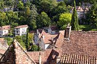 View over the rustic tiled rooftops of the picturesque clifftop tourist attraction village of St Cirq Lapopie, Lot, France, Europe.