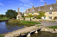 England, Gloucestershire, Cotswolds, idyllic old stone cottages at Lower Slaughter in autumn sunshine.