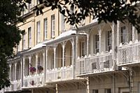 Ornate ironwork on the balconies that decorate the terraces of historic houses in the Clifton area of the City of Bristol, UK.