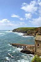 Early summer afternoon sunshine after a storm on the old lifeboat station at Lizard Point in the Lizard Peninsula, Cornwall, UK.