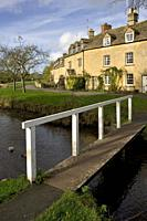 England, Gloucestershire, Cotswolds, Lower Slaughter in autumn, riverside cotswold stone cottages.