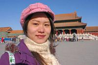 Portrait on a Chinese girl as tourist on Tiananmen Square, Beijing, China.