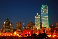 The Dallas Texas Skyline glows against a Dusk sky.