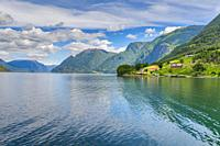 the seashore and ferry stage of Solvorn, Norway, panorama of Lustrafjorden with mountains.