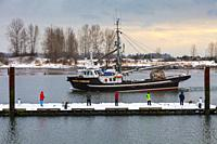 People fishing from a floating dock on the banks of the Fraser River in Steveston. British Columbia. Canada.