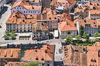 View over the capital Ljubljana to the buildings of the old town and to the shoemakers bridge (Sustarski most). The bridge was built in the 13th centu...