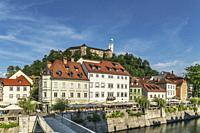 View from the old town of Ljubljana over the bridge Ribja brv (fish-pier) and over the river Ljubljanica to the castle of Ljubljana. The Ljubljana Cas...