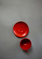 Cup and plate red of glass.