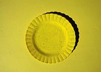 Yellow plate on yellow background.