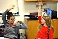 7th Grade Girls Chatting in Classroom, Wellsville, New York, USA.